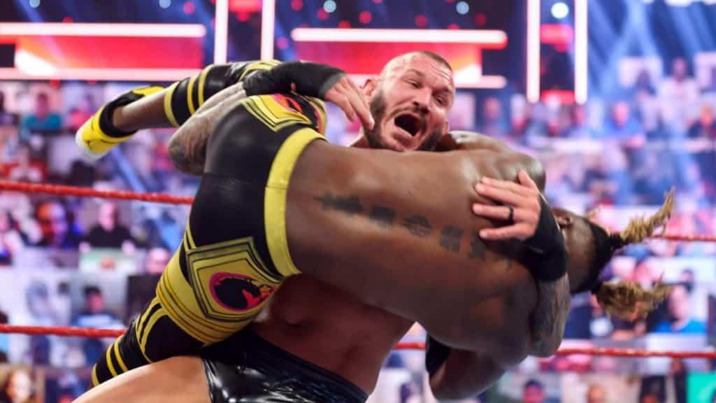 Randy Orton holding Kofi Kingston