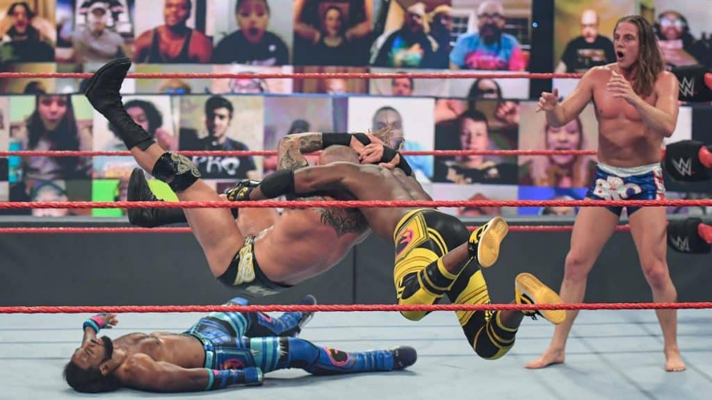 Randy Orton RKOs Kofi Kingston with Xavier Woods already RKO'd and Riddle looking on in horror
