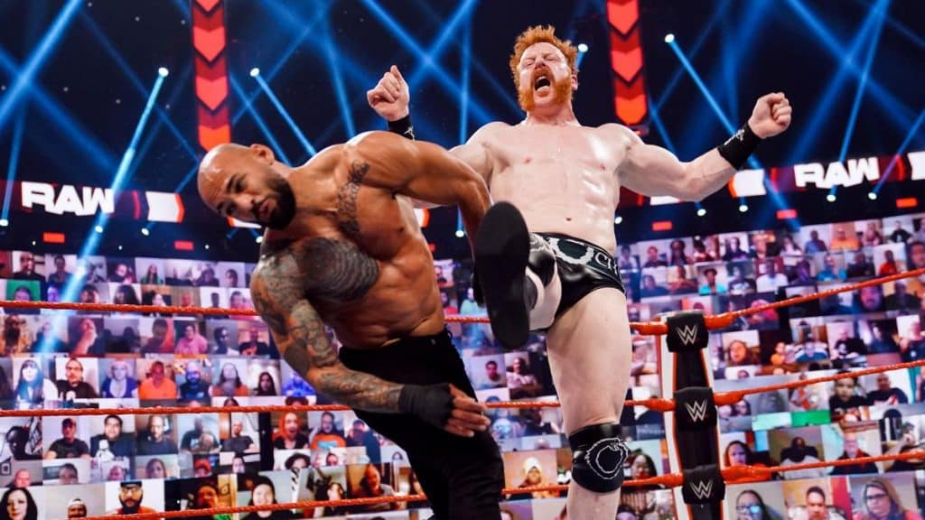 Sheamus kicks Ricochet in the face