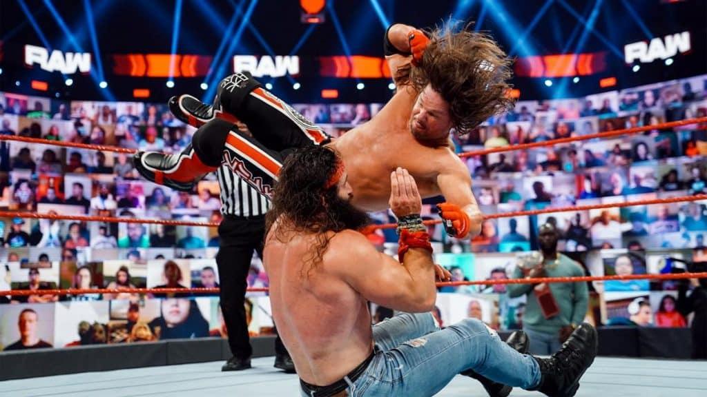 AJ Styles drops an elbow on Elias