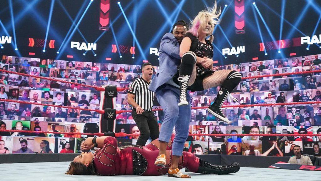 Reginald lifts Alexa Bliss off Nia Jax