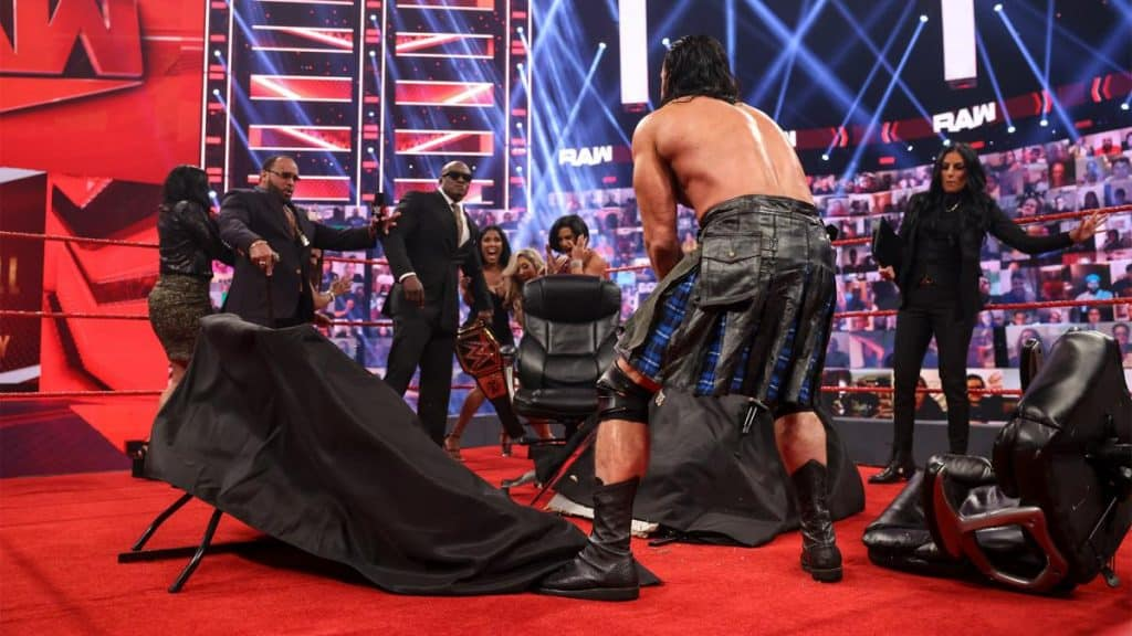 Drew McIntyre cuts the contract signing table in helf