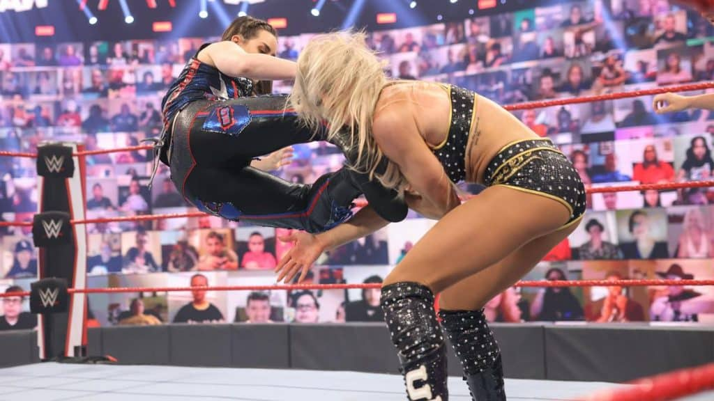 Nikki Cross dropkicks Charlotte Flair