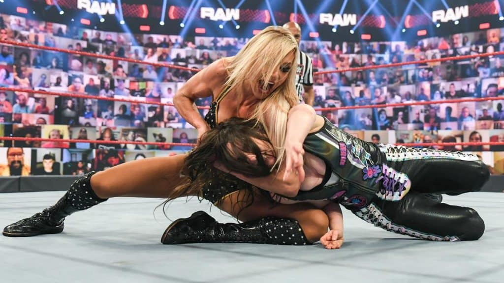 Charlotte Flair with Nikki Cross in a headlock