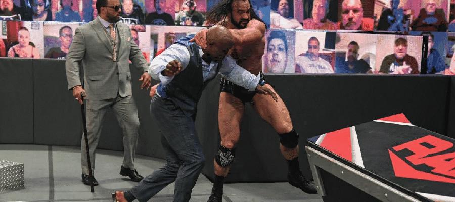 Drew McIntyre throws Bobby Lashley into the barricades