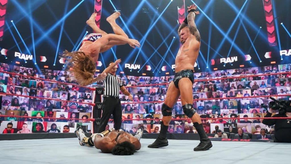 Randy Orton throws Riddle onto Xavier Woods
