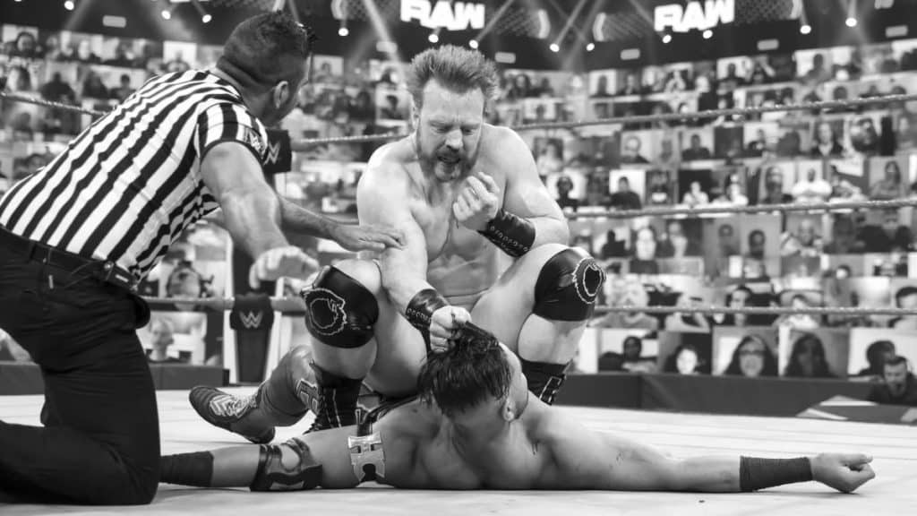 Sheamus with Humberto Carrillo by the head