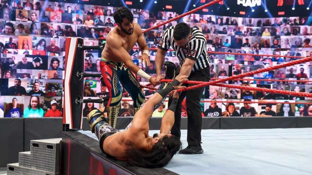Mansoor helps Mustafa Ali out of the ropes