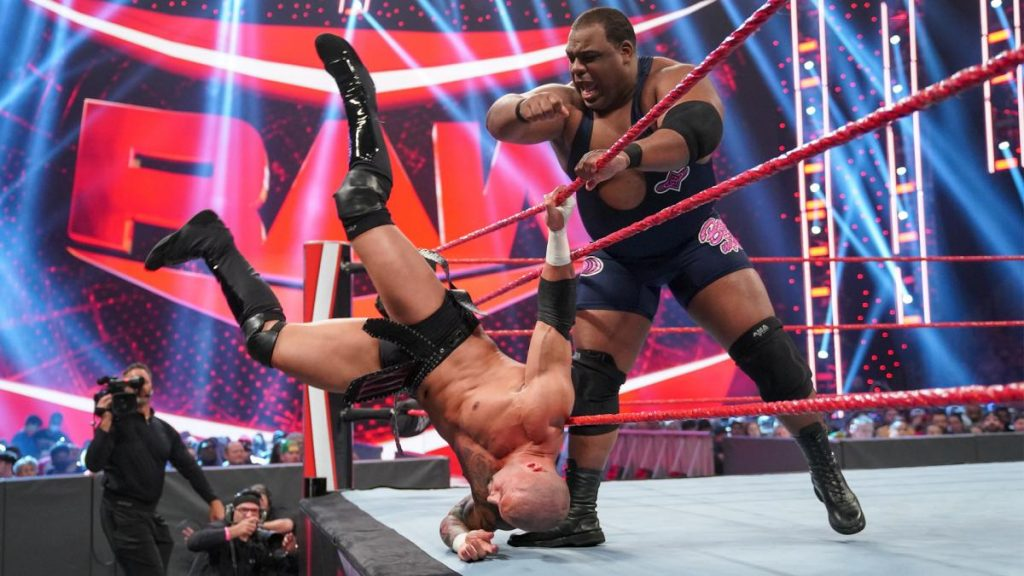 Keith Lee tips Karrion Kross out of the ring