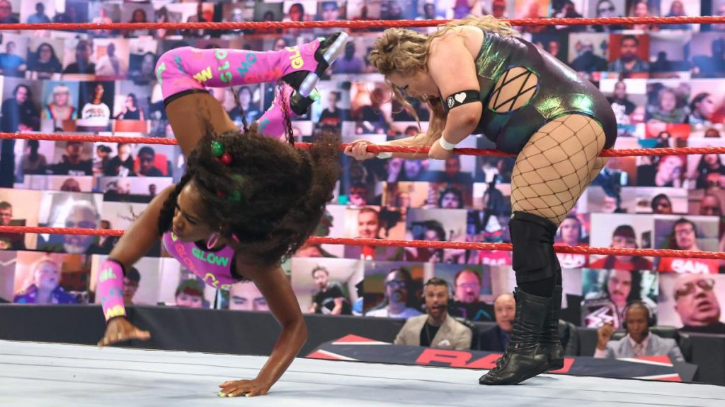 Naomi dropkicks Doudrop