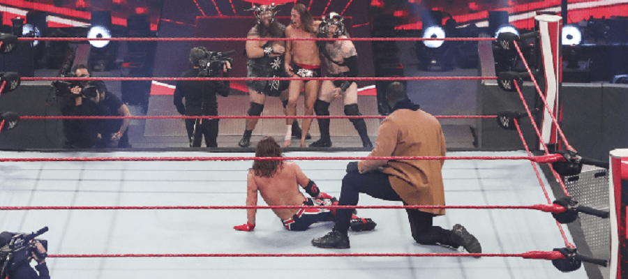 AJ Styles and Omos watch Riddle and The Viking Raiders leave