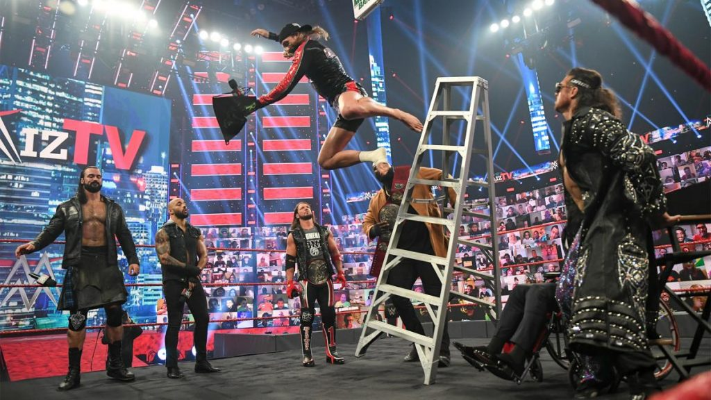 Omos shoves Riddle off a ladder