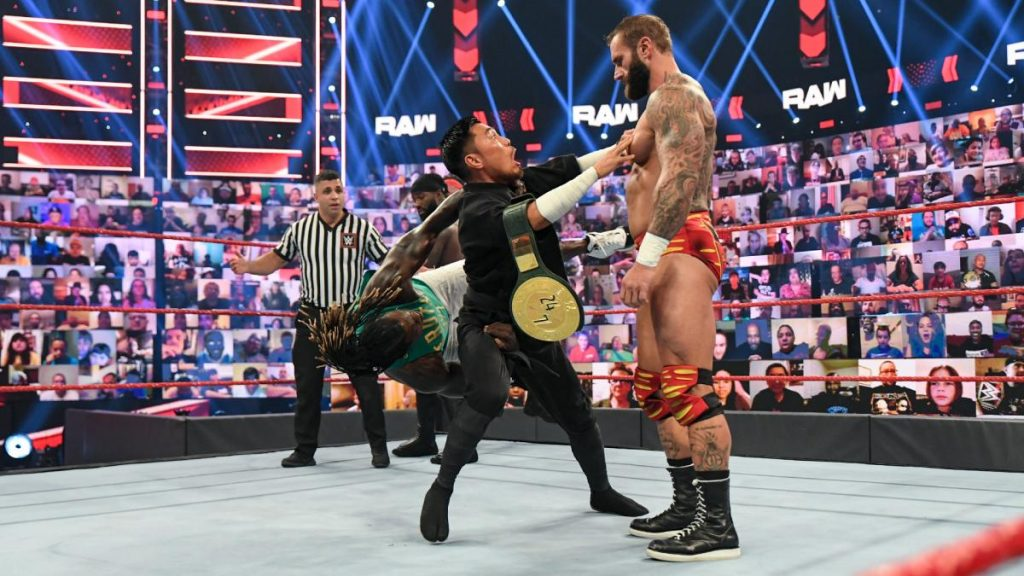 R-Truth tries to pin Akira Tozawa who has just run into Jaxson Ryker