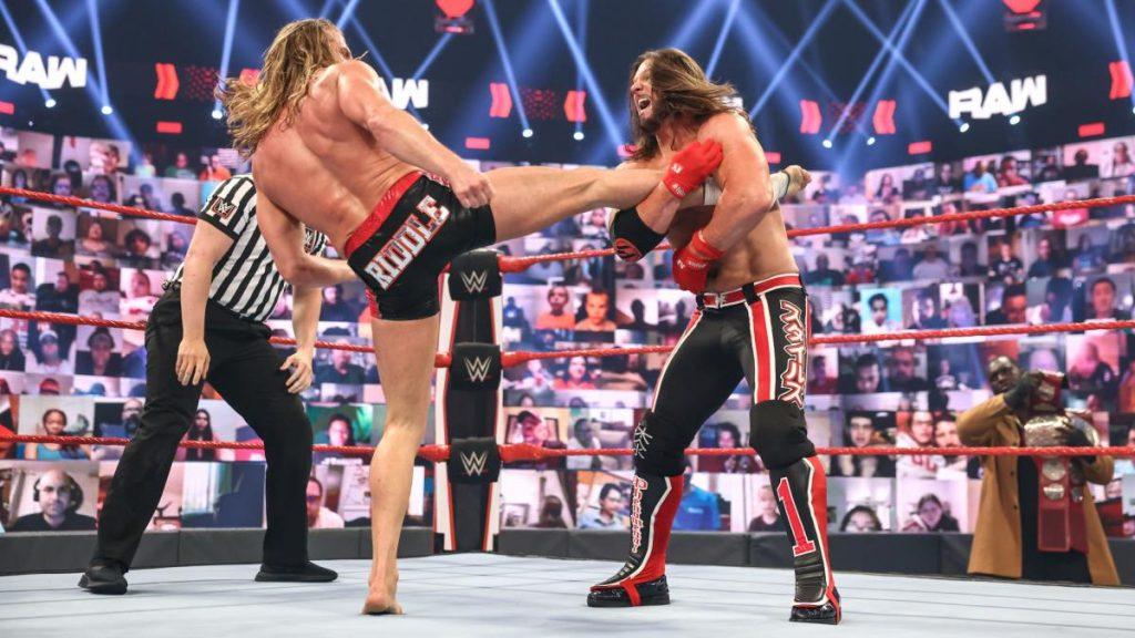 AJ Styles grabs Riddle's injured leg