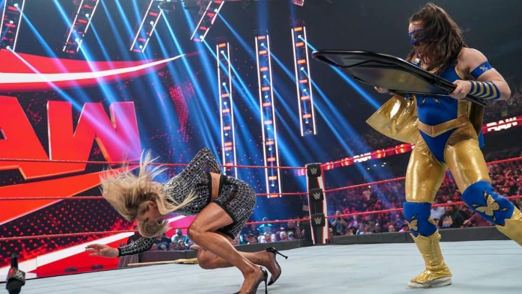 Nikki A.S.H. hits Charlotte Flair with a chair