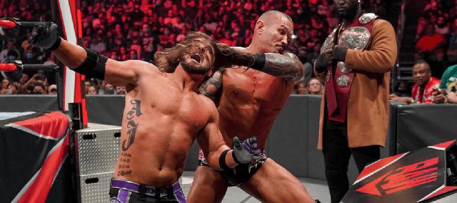 Randy Orton throws AJ Styles into the announce desk