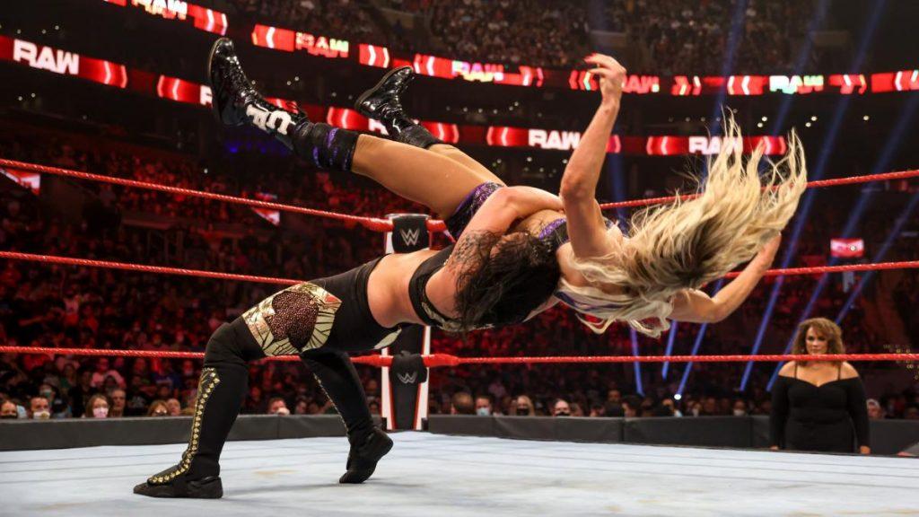 Shayna Baszler suplexes Charlotte Flair