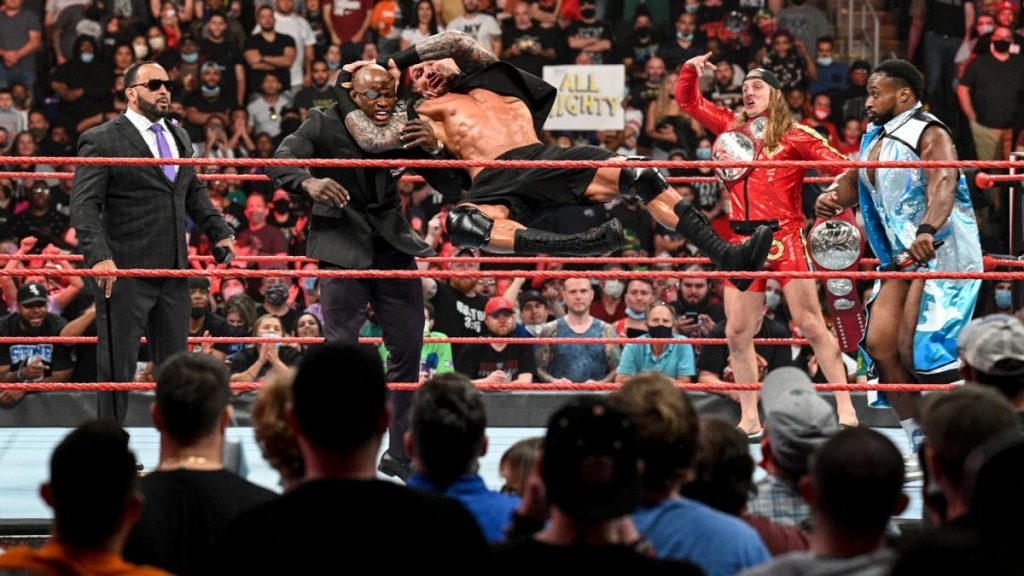 Orton RKO's Lashley in front of MVP, Riddle, and Big E