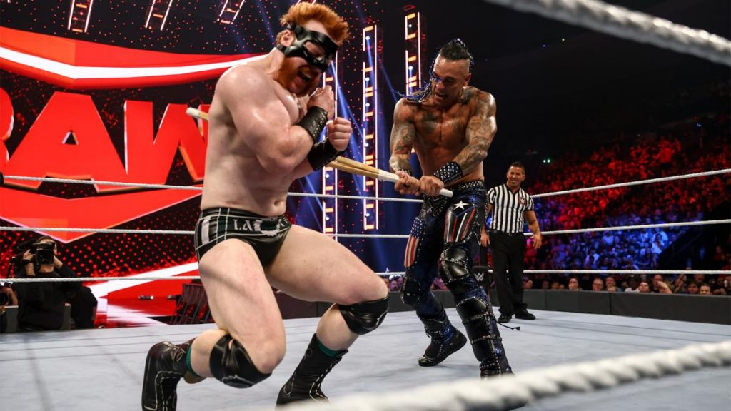 Damian Priest hits Sheamus with a kendo stick