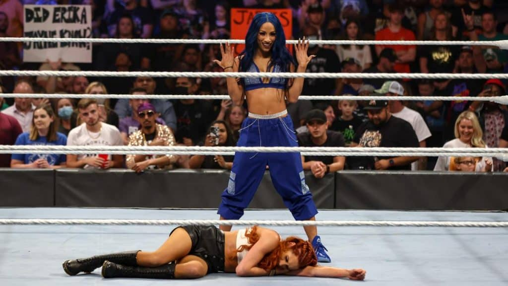 Sasha Banks stands over Becky Lynch