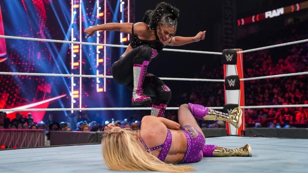 Bianca Belair stamps on Charlotte Flair
