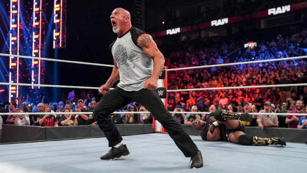 Goldberg with Shelton Benjamin laid out in the background