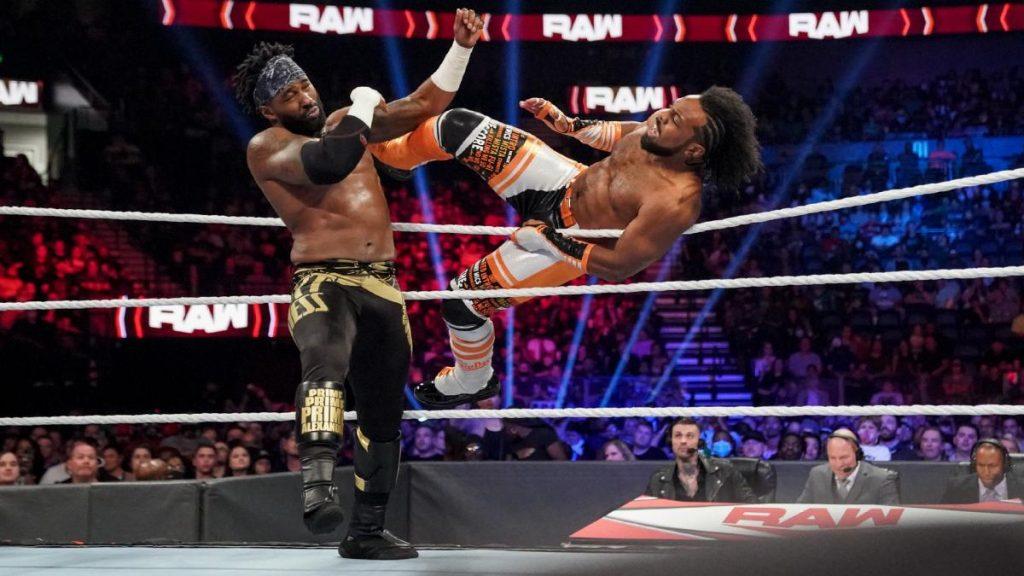 Xavier Woods kicks Cedric Alexander in the head